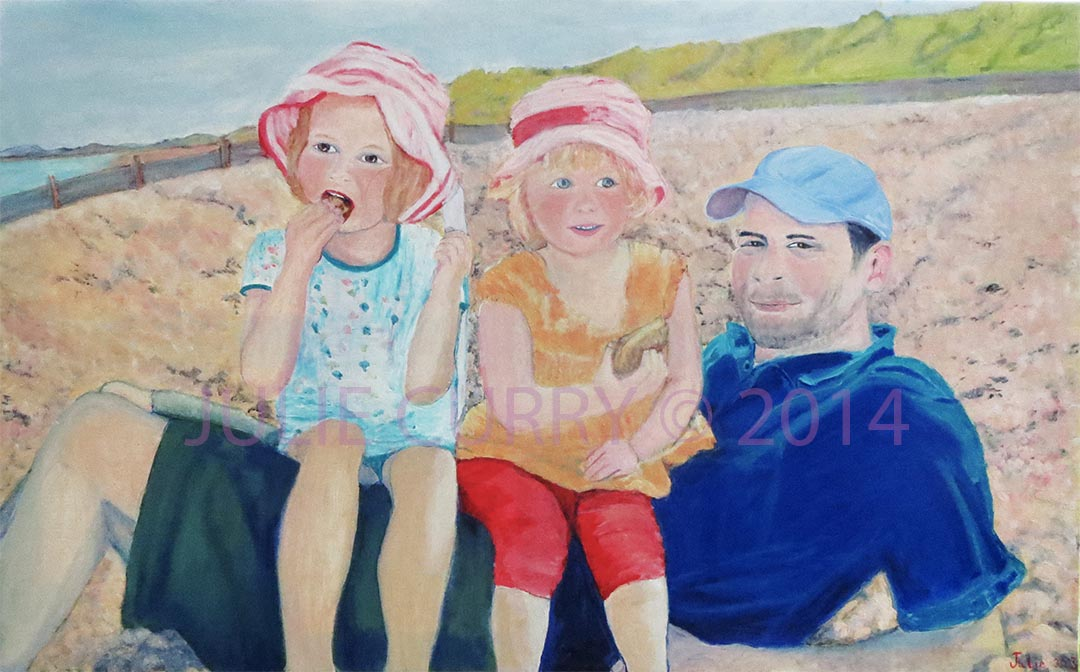 An oil painting portrait of 2 girls and a father sitting on a stony beach by Julie Curry an oil painter
